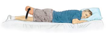 Man with amputated leg lying on stomach with head supported by pillow. Arrow shows him lifting amputated leg up.