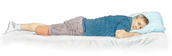 Man with amputated leg lying on stomach with head supported by pillow.