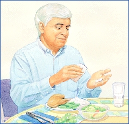 Man sitting at table about to eat dinner, taking pill out of bottle. Glass of water is on table.