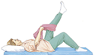 Woman lying on mat with pillow supporting head. One knee is bent with foot flat on floor. Towel is looped around other knee. Woman is holding ends of towel and pulling to raise leg.