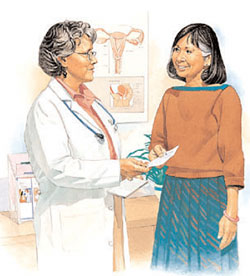 Healthcare provider handing prescription to woman.