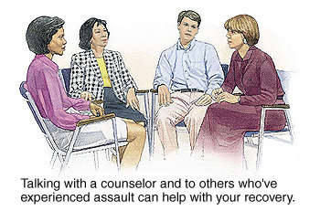 Four people in group discussion. Talking with a counselor and others who have experienced assault can help with recovery.