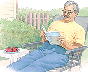 Man sitting outside reading book.