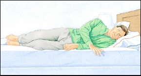 Man lying at edge of bed on his side.