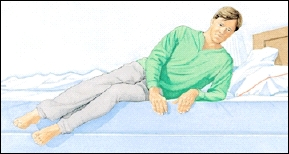 Man lying at edge of bed on his side with feet over edge of bed. He is supporting his upper body on one bent elbow.