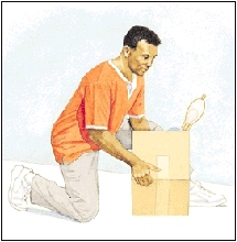 Man kneeling on one knee to pick up box.