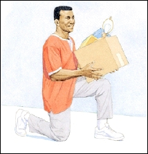 Man kneeling on one knee, holding box.