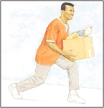 Man standing up from kneeling, holding box.