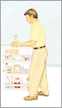 Man standing in front of open refrigerator holding food.