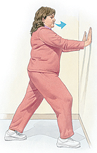 Woman facing wall, supporting upper body with palms on wall at shoulder height. Right knee is bent, left leg is extended behind her with foot flat on floor. Arrow shows her exhaling.