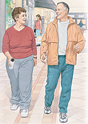 Man and woman walking indoors at shopping mall. Woman is holding water bottle.