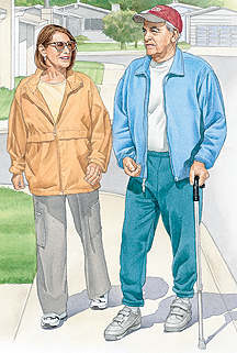 Man with cane and woman walking outdoors.
