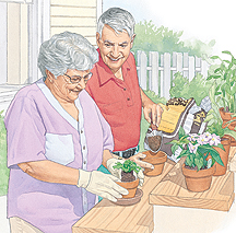 Man and woman putting plants in pots.