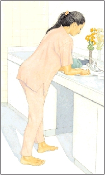 Woman bending over at sink, supporting weight on her forearms.
