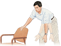 Man holding onto chair and bending over at waist with one arm hanging. Ghosting shows him swinging arm back and forth from shoulder.